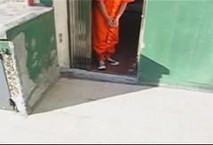 Prisoner walking in AHC Auto Restraints (asiancuffs) Tags: prison shackles handcuffs prisoner handcuffed