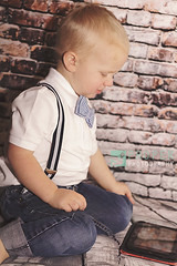 Distraction (Proper Photography) Tags: boy portrait baby cute brick happy photography toddler adorable content littleboy distracted distraction properphotographycanon 7dcanonproper