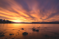 Sunset Over Okanagan Lake (eric.vanryswyk) Tags: trees sunset red sky orange sun lake canada mountains water yellow clouds forest river landscape dawn twilight nikon long exposure angle dusk okanagan westbank wide over columbia hills british kelowna 20mm 20 february nikkor f28 2016 d610