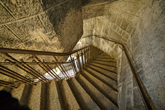 Curved staircase in tower (Digikuvaaja) Tags: old building castle geometric stone wall architecture stairs turn spiral hall ancient europe stair floor interior empty grunge steps perspective corridor entrance twist medieval architectural stairway lobby indoors staircase railing chateau curved majestic hdr steep rundown descending