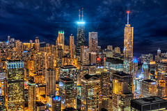 The New Hancock Beacon (Mister Joe) Tags: above longexposure windows sky urban usa signs chicago streets tower skyline modern night marina dark landscape golden 3d illinois nikon downtown neon cityscape view skyscrapers loop dusk sears united large joe aerial pop lakemichigan lakeshoredrive il crown glowing dynamicrange michiganavenue hancock fullframe trump iconic beacon hdr willis offices lakefront rockandroll daley blend mariott cityscenes hancockobservatory d600 allergen viewfrom lekas nighthdr 400north aerialchicago architectureandstructures