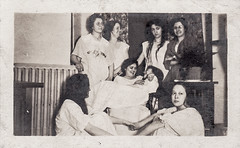 Two women embracing during a sleep over (oakenroad) Tags: old woman white black monochrome vintage lesbian found blackwhite sleep antique snapshot over photograph vernacular pajamas interest sleepover foundphotograph embracing lesbianinterest