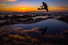 yeeha! (traycg1) Tags: sunset reflections jump sandiego action sunsetcliffs