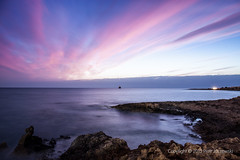 Sunset (PeterJot) Tags: longexposure travel sunset sea sky nature clouds landscape outdoors lights twilight europe ship cyprus wave vessel nopeople coastline mediterraneansea cloudsky rockobject