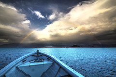 Dreams comes true (Mauricio Narea) Tags: chile travel sunset patagonia sun lake seascape beauty arcoiris clouds fun lago landscapes boat amazing rainbow quiet awesome calm cloudscape coyhaique