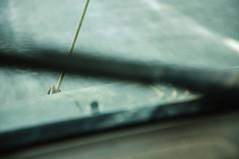 DSC_9743 [ps] - Geometric Mobile (Anyhoo) Tags: uk travel blur travelling wet water rain tarmac rope line motionblur asphalt bonnet windscreen windscreenwiper viewfromthecar anyhoo tiedon photobyanyhoo