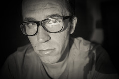 Meantime life outside goes on all around you (Andrew Baros) Tags: portrait selfportrait man look glasses eyes autoritratto ritratto occhiali stanco