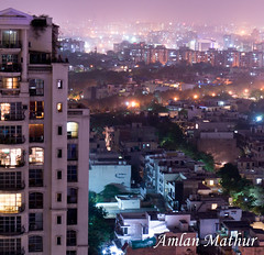 A night on the town (Amlan Mathur) Tags: longexposure houses urban india building home up architecture modern night skyscraper dark lights high asia apartments cityscape flat delhi aerial gurgaon development highup offices multistorey urbanization gurugram
