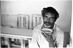 Untitled (vytautas ambrazas) Tags: life travel portrait india look photography eyes tea streetphotography 35mmfilm ilfordhp5plus400 analogphotography chai gujarat chaishop filmphotography travelphotography dwarka documentaryphotography olympusom50mmf14 olympusom3 maninachaishop