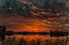 World in flames 2 (piotrekfil) Tags: sunset sky sunlight lake reflection nature water clouds landscape evening twilight pentax cloudy dusk poland sigma1750mmf28 piotrfil