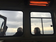 On the ferry to Bursa from Istanbul (Mink) Tags: winter sky woman cold men ferry clouds turkey interior strangers heater inside burqa lookingout