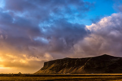 Cliff in sunset (imagesbystefan.com) Tags: travel sunset sky cliff mountain tourism nature beautiful stone night clouds landscape iceland europe outdoor dusk background south scenic dramatic nobody icelandic