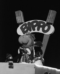 Bippo the Hippopatamus throws out  big toy toothbrushes (Monceau) Tags: blackandwhite monochrome parade mardigras float dentist toothbrushes hippopatamus kreweofeve bippo