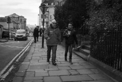 Father & Son (Alexander Jones - Documentary Photography) Tags: street england white black west monochrome photography nikon bath candid south north documentary somerset east moment decisive d3000