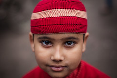 Boy in Red (paulpaulpauly) Tags: boy red portrait face eyes muslim dhaka bangladesh bangladeshi