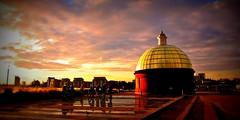 Sundown at Greenwich (doods-off/on) Tags: city blue sunset red sky orange brown sun sunlight london wet yellow landscape colours sundown cloudy greenwich leadingline