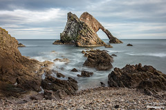 Bow Fiddle Rock - Portknockie (Rory Marland) Tags: old uk longexposure travel blue winter light sea wild sky cold tourism water glass colors beautiful beauty lines rock stone clouds composition canon outdoors photography lights scotland long arch colours wind outdoor nowhere north smooth dramatic wave overcast pebbles cliffs historic hidden northsea bow mysterious jagged fiddle gps tradition atmospheric moray multicolour cullen 6d buckie 2470mm britishculture leadingline portknockie colourimage metamorphicrock visitscotland bowfiddle bowfiddlerock nd24 naturalseaarch formatthitech rorymarland cullenquartzite neoproterozoicera