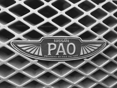 Badge : Nissan PAO  'produced by the Pike Factory ' (John(cardwellpix)) Tags: uk by factory nissan surrey retro april pao 11th pike monday guildford produced 2016
