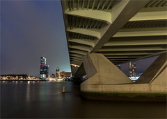Under the bridge (zilverbat.) Tags: longexposure nightphotography travel bridge urban ny netherlands dutch night dark photography town rotterdam nightlights nightshot image availablelight thenetherlands visit le timelife avond maas luxor kopvanzuid 010 afterdark beton brucke rotjeknor waterstad lenight avondfotografie rotterdambynight katendrecht beeldbank maasoever maasstad longexposurewater dutchholland zilverbat longexposurebynight photographybynight longexposurenetherlands