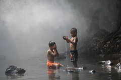 boys playing water (nuttawut.jaroenchai) Tags: travel friends boy sea summer vacation two people lake playing male nature boys water kids children fun outside happy person kid jumping child play outdoor joy young happiness off leisure activity