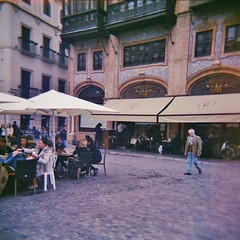 Robles Laredo (sonofwalrus) Tags: windows building film architecture bar holga cafe lomo lomography spain europe seville scan tables umbrellas robleslaredo