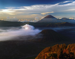 Primeval earth (Robyn Hooz) Tags: sunrise indonesia landscape java alba gas volcanoes cones bromo coni vulcani