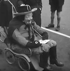 Just check the guy before giving out the prize (theirhistory) Tags: boy england hat kid child play mask trousers shorts wellies rubberboots pram pushcair