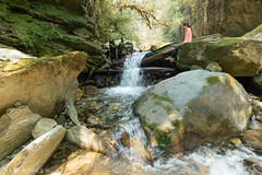 Girl sitting by idyllic Jungle waterfall in Nepal (SamKent22) Tags: nepal nature girl outdoors waterfall rocks stream sitting exploring adventure jungle greenery idyllic tranquil