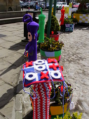 Knitted noughts and crosses (Nekoglyph) Tags: blue red white game green yellow cycling knitting purple o planters yorkshire crosses x characters knitted carpark cobbles thirsk tubs teletubbies bollards tinkywinky noughts yarnbombing tourdeyorkshire2016