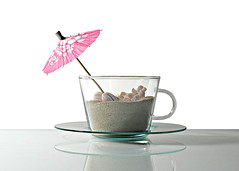 table beach (brescia, italy) (bloodybee) Tags: pink stilllife white beach cup glass coral fun sand tea humor shell paperumbrella 365project