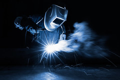 Welding (Patrick Foto ;)) Tags: blue man hot industry metal closeup fire construction iron industrial factory mask steel welding weld labor smoke duty working arc safety equipment flame repair metalwork workplace rod worker manual protective heavy laborer job spark protection tone tool flaming fill ironworks skill manufacture welder manufacturing skilled laboring