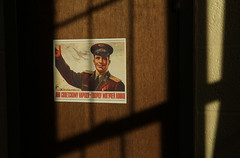 Propaganda (Pythaglio) Tags: door light shadow propaganda soviet bleak alphabet stark russian cinderblock cyrillic fauxwood tongueincheek