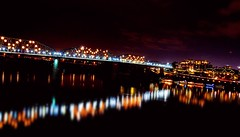 A Chattanooga Light Show (Roland 22) Tags: nightphotography winter sky clouds boats pier dock flickr glow boardwalk lamps tennesseeriver icecold warmtones bluffviewartdistrict chattanoogatennessee lightandreflection