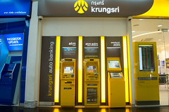 HUAHIN, THAILAND - FEB14, 2016: Bank Automatic Teller Machine (ATM) of Krungsri[y] on market village mall on 14 feburary 2016 (leykladay) Tags: city travel red money building tourism yellow shop architecture square thailand town cityscape tour exterior view bangkok famous decoration style bank center medieval business entertainment thai area transfer atm merchant banking cdm withdraw advertise payment units pum expenditure krungsri