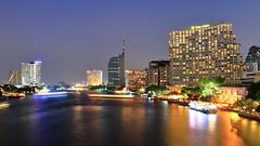Chao Phraya River (Dr.Bullshit) Tags: longexposure bridge light sky building river landscape thailand hotel boat twilight bangkok landmark shangrila thai th bkk chaophraya taksin