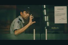 The man with a Message (arkamitralahiri) Tags: people india cinema mall streetphotography security spencers kolkata calcutta lightroom watchman