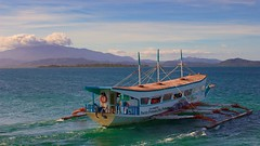 Banca boat, Palawan, Philippines (Ray in Manila) Tags: water clouds island boat asia pacific philippines transport tropical banca puertoprincesa pumpboat dospalmas hondabay sulusea arrecifeisland