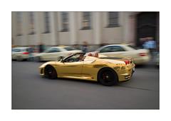 gold is in [Ferrari] (Istvan Penzes) Tags: street germany munich gold ferrari motionblur handheld penzes leicaelmarit28mmasph