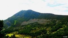 992 - Pico del Lago (esnalar) Tags: espaa naturaleza mountain nature clouds forest landscape spain paisaje bosque nubes mountaineering montaa len castillalen montaismo puertodetarna mampodre sx50hscanon picoremelende