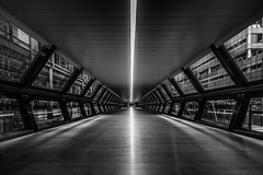Adams Plaza Bridge, Canary Wharf Crossrail Station, London (Davoud D.) Tags: bridge london monochrome vanishingpoint tunnel canarywharf onecanadasquare crossrail adamsplaza adamsplazabridge