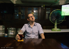 Pondering a tough week at the office. (SamKent22) Tags: man english beer pub sitting drinking thinking relaxed pondering fridaynight brenizer