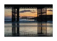 One man and his dog (hehaden) Tags: sunset sea dog man beach sussex pier sand brighton westpier lowtide pillars brightonpier palacepier