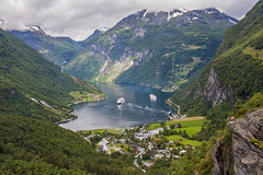 Geirangerfjord (Matthew on the road) Tags: road trip travel summer mountain mountains travelling nature water norway way boats boat norge town long ship village view ships north july august motorbike moto motorcycle cape fjord raid fiord capo norvegia nord northcape geirangerfjord nordkapp longway 2015 caponord summer2015 july2015 august2015 matthewnan matthewontheroad