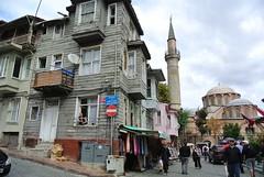 Behind Hagia Sofia  - Istanbul (Marian Pollock - Thanks for a million+ views) Tags: street houses people woman shop turkey streetscene istanbul mosque balconies hagiasofia weatherboardhouses