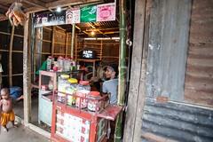 5D8_7180 (bandashing) Tags: poverty street england people shop manchester tin tv poor bamboo sweets sylhet bangladesh corrugated slum colony socialdocumentary aoa bandashing akhtarowaisahmed