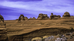 Delicate Arch from Delicate Arch Viewpoint (woodchuckiam) Tags: sky cliff color rock landscape utah sandstone arch scenic archesnationalpark rockformations delicatearch delicatearchtrail wolferanch delicatearchviewpoint woodchuckiam wolferanchdelicatearchviewpointroad
