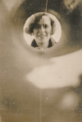 Young woman looking down a drainpipe (simpleinsomnia) Tags: old woman white abstract black monochrome vintage found blackwhite blurry antique snapshot photograph vernacular unusual foundphotograph