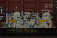 ? (TheGraffitiHunters) Tags: street blue white black art face car yellow train nose graffiti colorful paint arm box teeth watch tracks spray boxcar freight benched benching