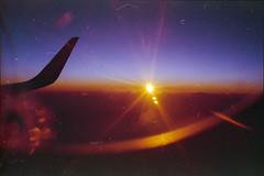 (333Bracket) Tags: camera light sunset sky sun london film plane 35mm fly darkness sink explosion rangefinder down flare analogue hue explode canoncanonetql17giii fujixtra400 333bracket