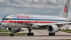 I often get distracted by shiny things... (Matt N Reynolds) Tags: summer man manchester shiny aviation overcast boeing americanairlines runway 2014 boac 757200 avgeek 23l n199an